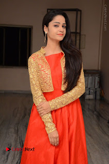 Telugu Actress Divya Nandini Stills in Orange Sleeveless Gown at Chennai Chaitrama Movie le Launch Event  0004.JPG