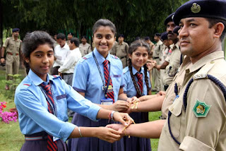Siliguri Model School girls tying Rakhis to SSB jawans