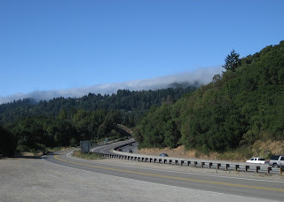 Old Santa Cruz Highway parallels Highway 17, with fog capping the top of the Santa Cruz Mountains