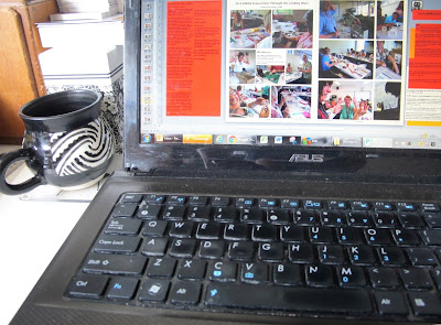Laptop computer, showing a magazine in the process of being laid out.