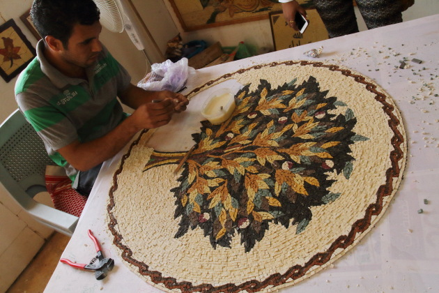 Mosaic artist creating the tree of life mosaic at Madaba, Jordan