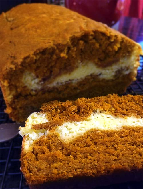 Pumpkin Cheesecake Bread. Delicious, simple to make, pumpkin bread with a layer of creamy cheesecake in the middle. It's delicious!