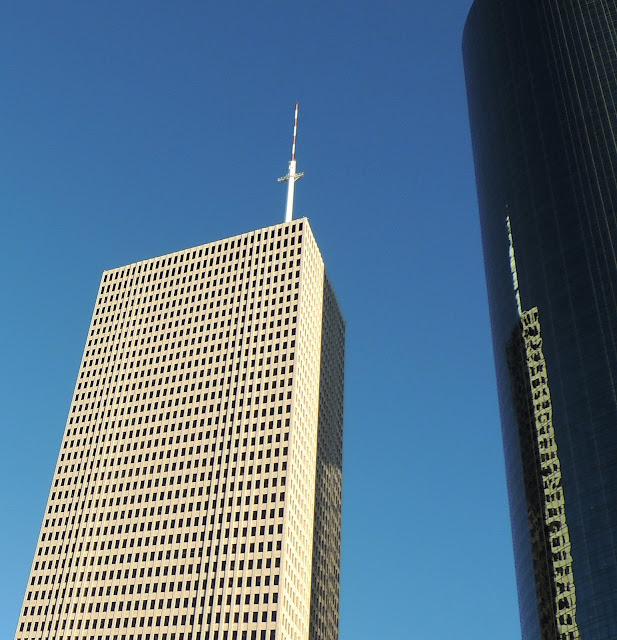 One Shell with roof-top transmission tower x 2 (mirror image on face of Wells Fargo Plaza)