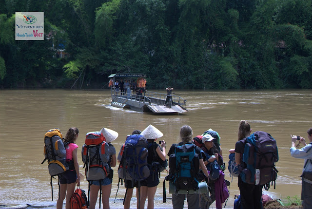Tourists are waiting to the ferry to across Dong Nai river for Nam Cat Tien National Park