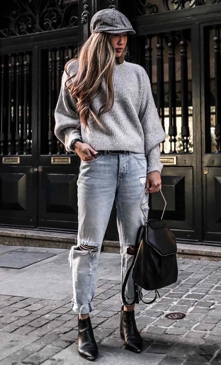 best fall outfit / hat + grey sweater + backpack + ripped jeans + boots
