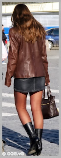 Girl in brown leather jacket on the street