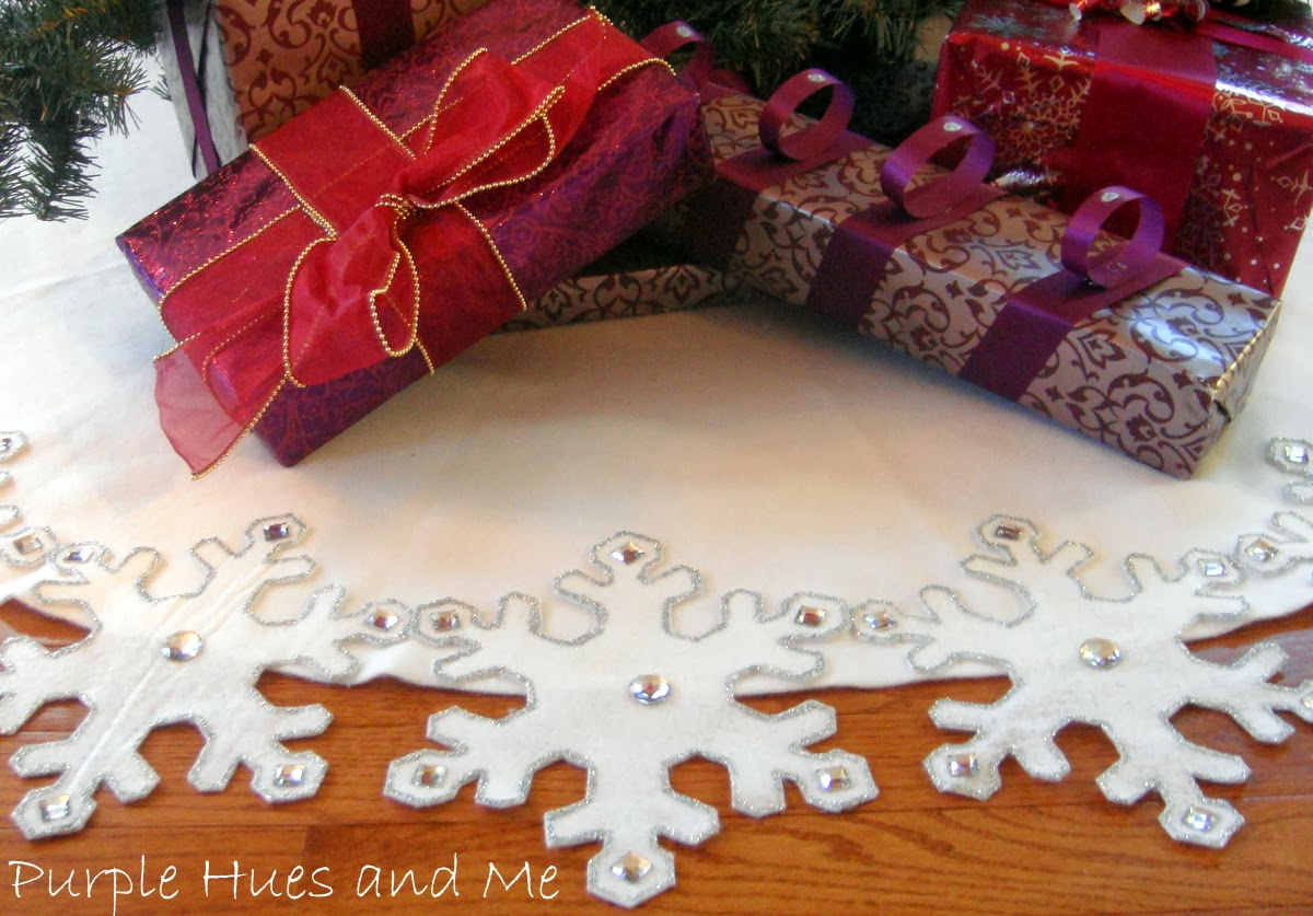each snowflake is hand cut and highlighted with silver crystals to make this a glistening holiday favorite
