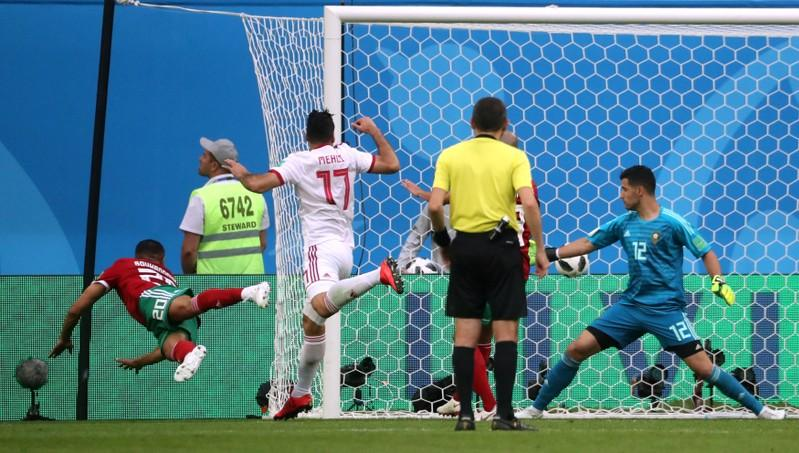 Iran won their group opener after Morocco s Aziz Bouhaddouz scored an own  goal in stoppage time to give Carlos Queiroz s team the three points and  top spot ... 1be572df75ad