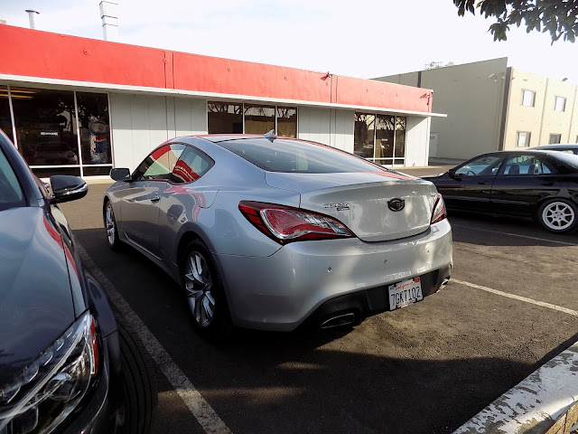 2014 Hyundai Genesis Coupe with damaged fender, door & quarter panel after collision repairs at Almost Everything Auto Body