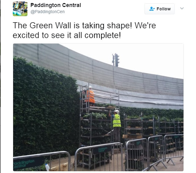 Tweet showing the green wall's construction in progress