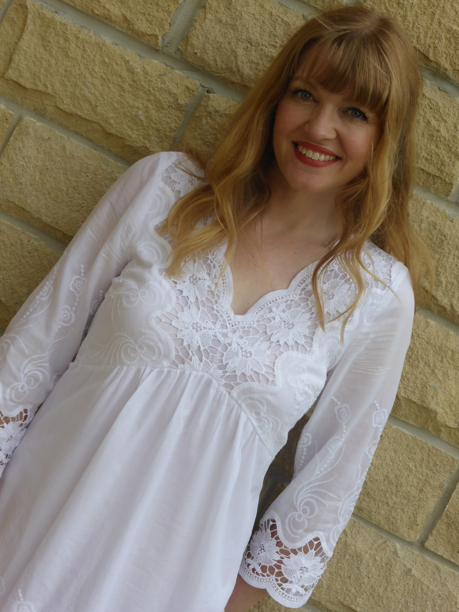 Over 40s blogger What Lizzy Loves wears white embroidered lace summer dress with high-heeled strappy sandals