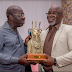 Obaseki presents a souvenir to Amaju Pinnick, Chairman NFF [photo]
