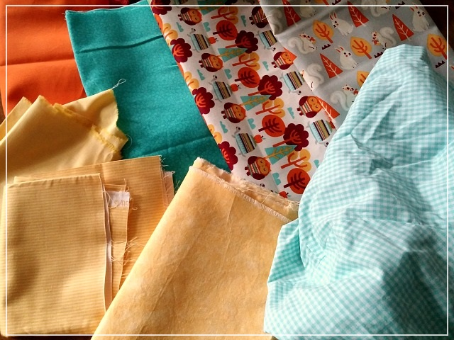 Fabric Choice Simple Squares Patchwork Baby Quilt in Yellow, Orange and Blue by Puppilalla