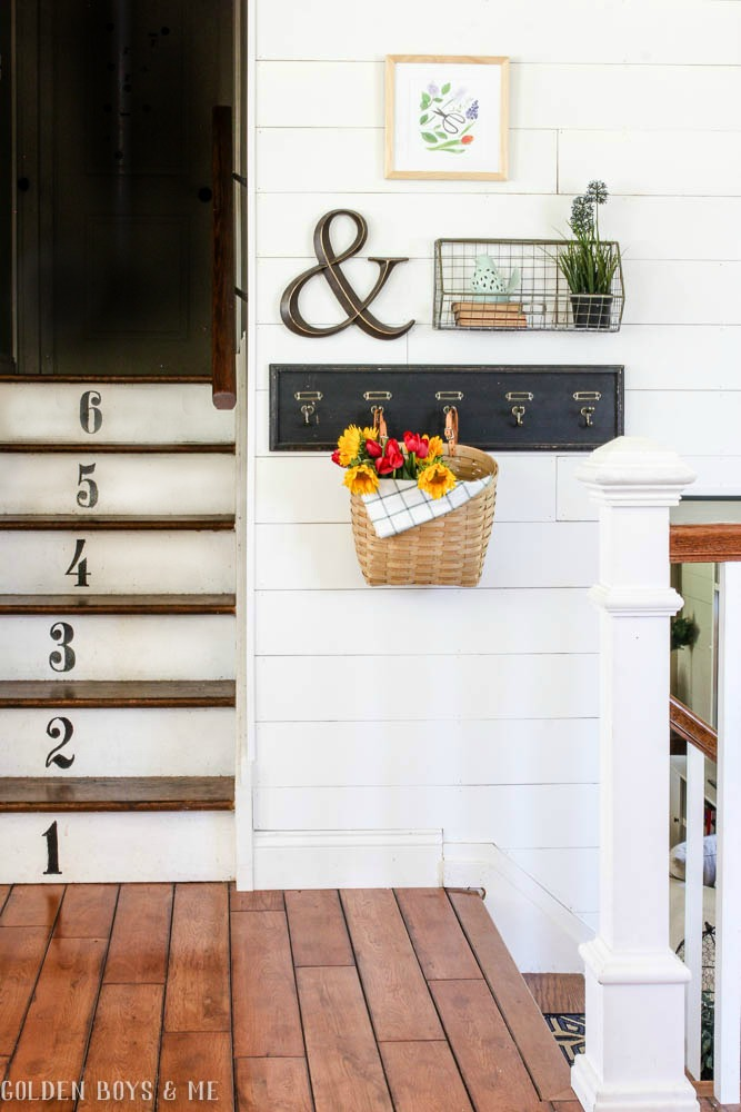 Entryway with planked gallery wall and numbered stairs