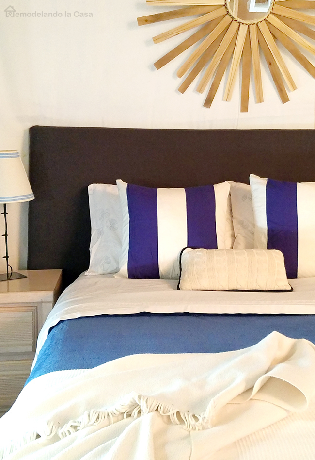 diy Sunburst mirror, basement bedroom, navy blue headboard, white walls
