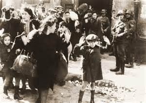 Jewish children and their parents being terrorized by Nazi confiscations of possessions, homes and businesses, and arrests of the innocent. Photo: Warsaw, ca. Apr. 1943, The New York Times