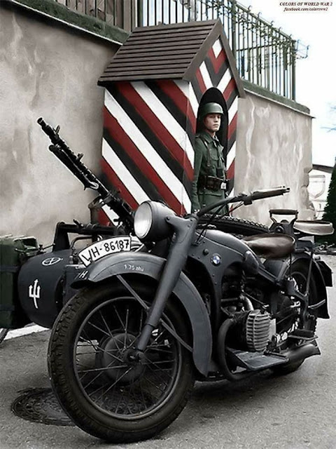 A German sentry in France circa 1941 with his BMW R75 motorcycle, worldwartwo.filminspector.com