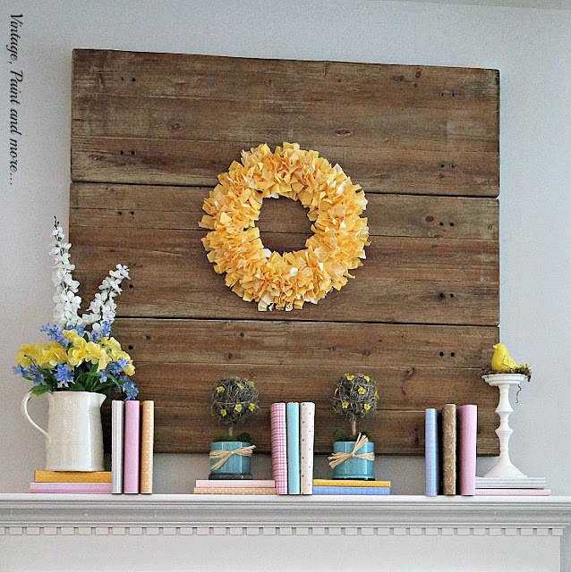Spring mantel done with covered books, ironstone pitcher and diy topiaries.