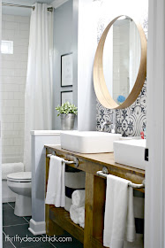 Bathroom makeover with wood vanity and round mirrors