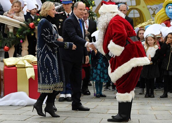Prince Albert II, Princess Charlene, Louis Ducruet and Camille Gottlieb attended Children's Christmas ceremony