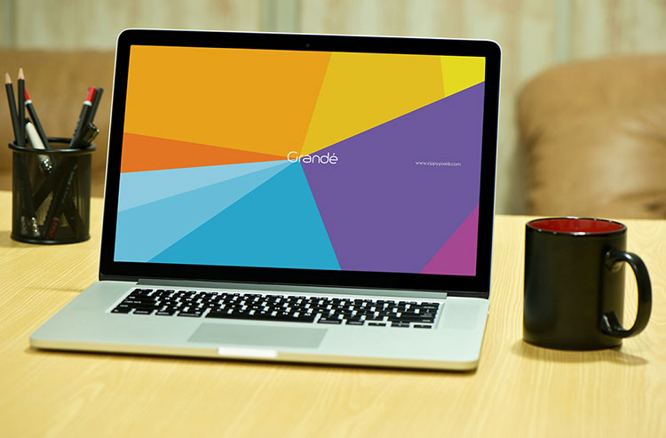 Free Photorealistic Device Mockup of Macbook Pro