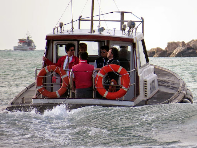 Pilots on a pilot boat, port of Livorno