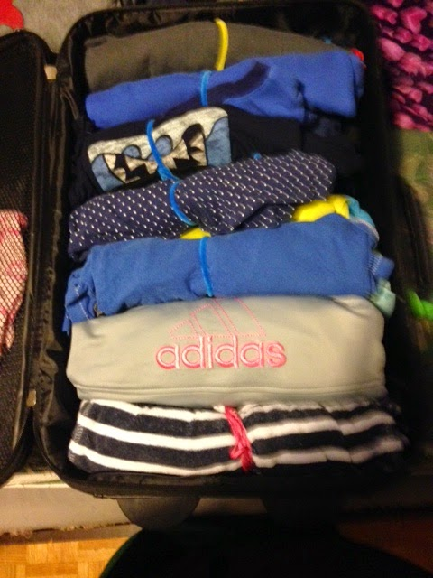 packing tricks and tips for kids, rolling clothes suitcase