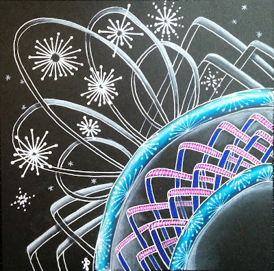 abstract drawing of fireworks on black paper