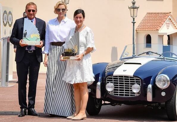 Princess Charlene wore Akris Punto striped flared skirt. Prince's Palace of Monaco after a parade in Monte-Carlo classical car event