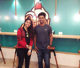 Keerthy Suresh in Black Dress with Cute and Lovely Smile with a Lucky Fan