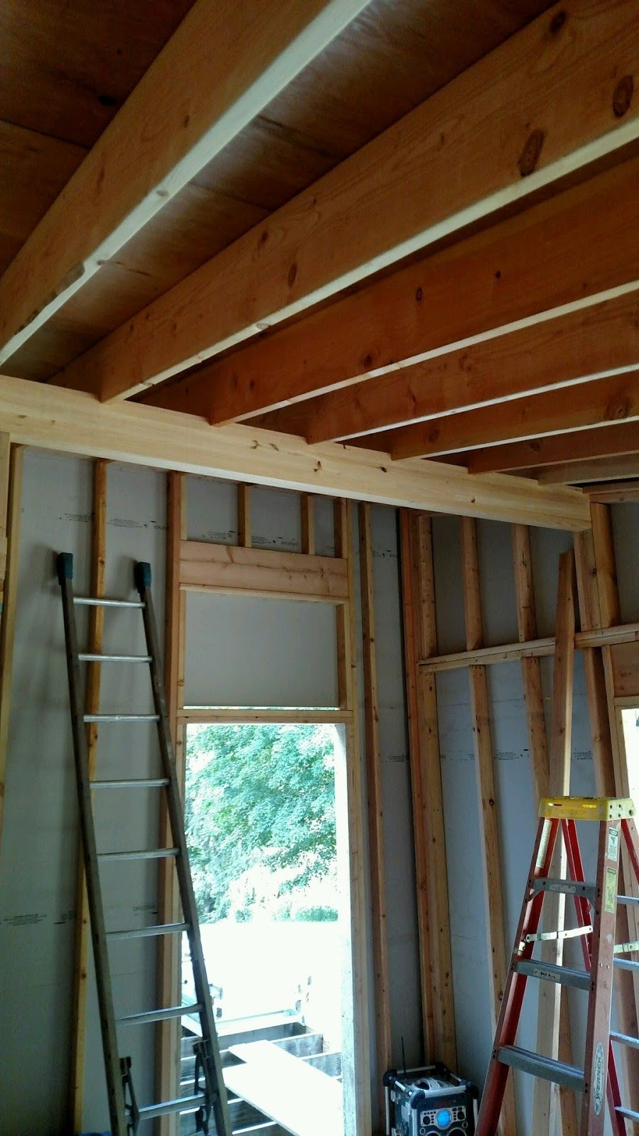 Exposed Glulam Beams ~ The new house next door wood and not