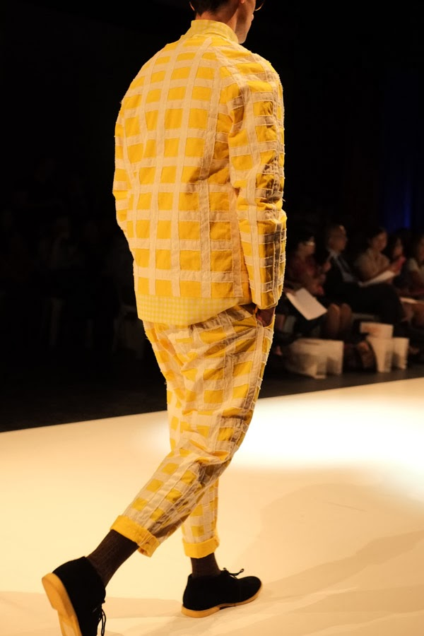 Matiny Ng; yellow and white large check pattern jacket and pants with large round pocket motif; rear view - Menswear : Raffles Graduate Fashion Parade 2013  Photography by Kent Johnson.