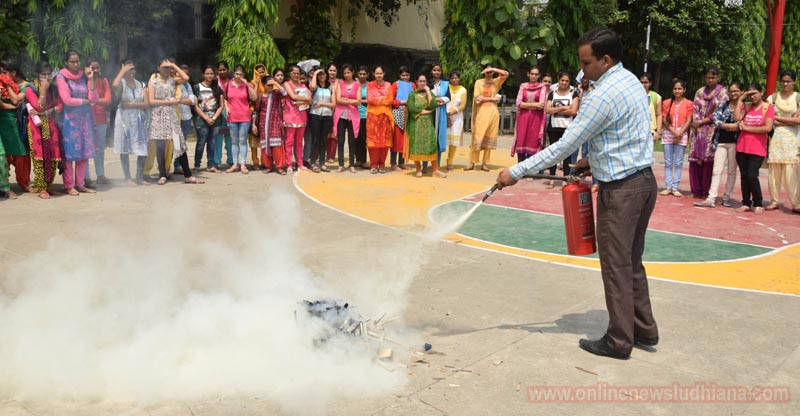 Expert demonstrating application of fire extinguishers during workshop
