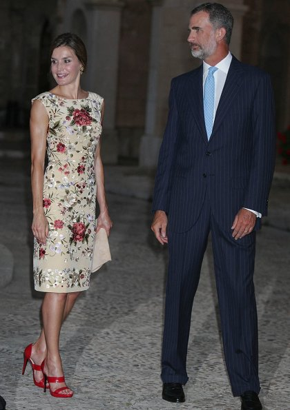 King Felipe and Queen Sofia at Almudaina Palace. Queen Letizia wore a malina print dress and Magrit shoes