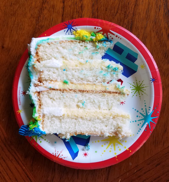 slice of white layer cake with vanilla pudding filling
