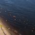 Homem tenta afogar ex-namorada na praia da Ponta Negra após vê-la com outro