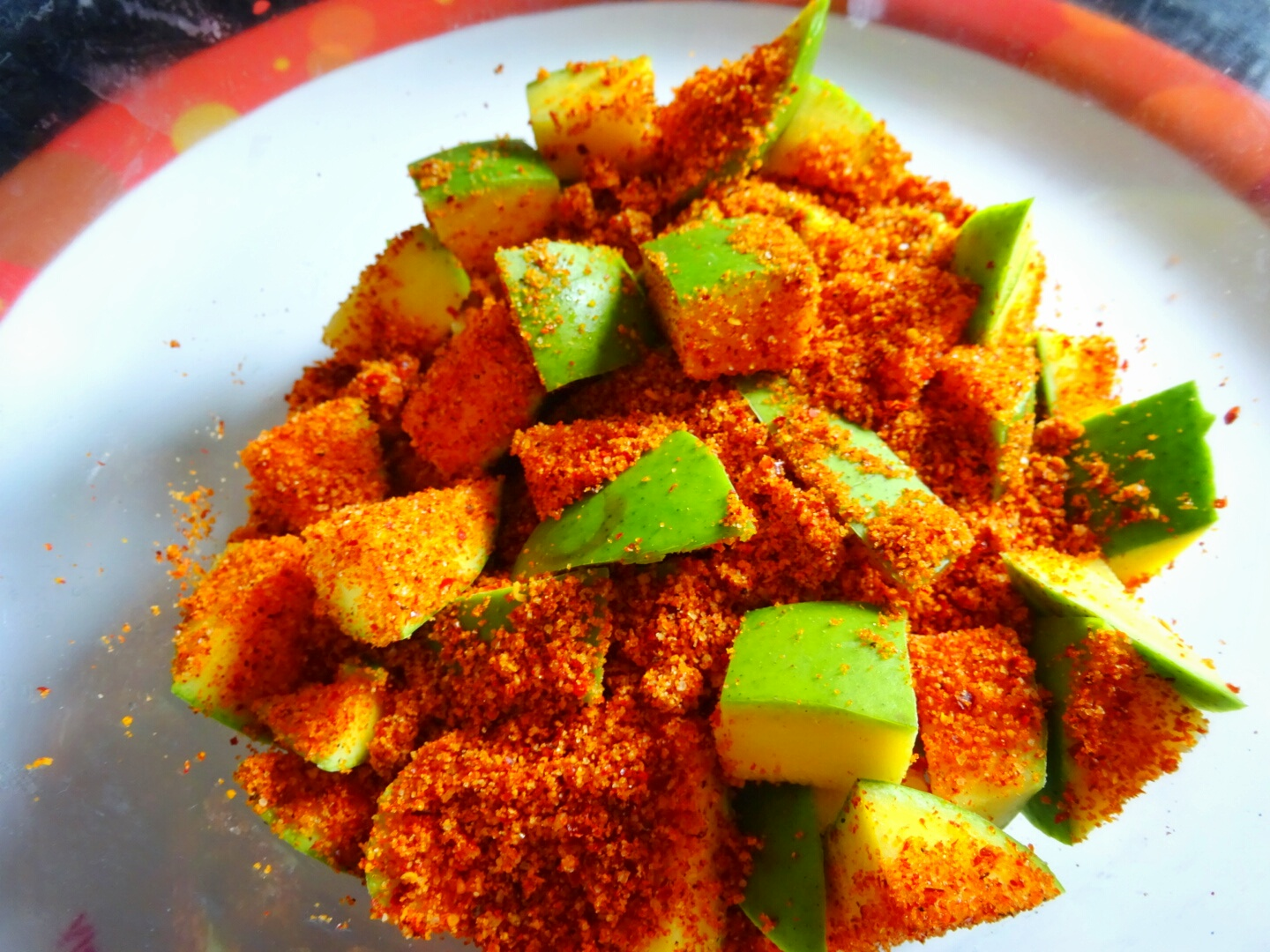 ™�cut The Mangoes Into Small Cubes Or As Desired, But Don't Peel The Skin  Add Mango Pickle Masala And Mustard Oil, Mix Well