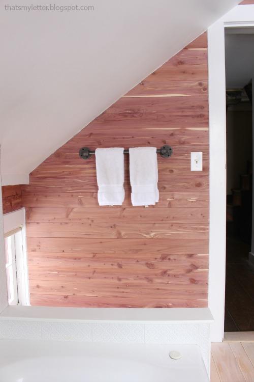 bathroom cedar walls pipe hardware