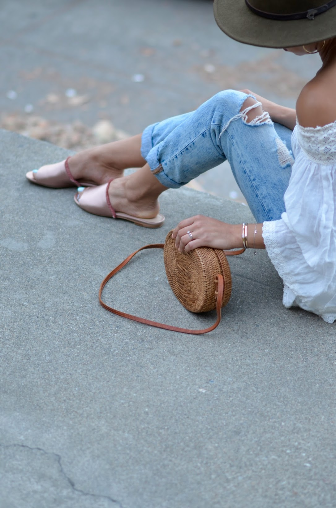 M. Gemi Tenidas, off the shoulder linen top, straw bag from Bali, round straw bag, Levi's 501