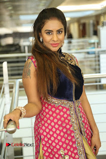 Telugu Actress Sri Reddy Mallidi Stills in White Beautiful Dress at Marriage Needs Bridal Fashion Week 2017 Logo Launch  0102.JPG