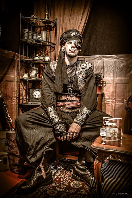 Man dressed in Steampunk clothing as an arabic/nomadic Steampunk bedouin character. includes turban.