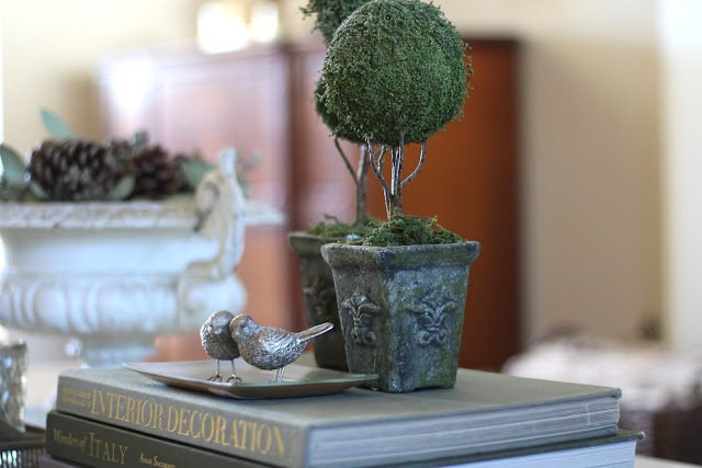 styling a coffee table topiaries silver birds fall