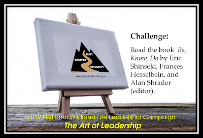 "easel with a canvas showing the Wildland Fire Leadership Development Program logo and challenge: Read the book ""Be, Know, Do"" by Eric Shinseki, Frances Hesselbein, and Alan Shrader (editor)."