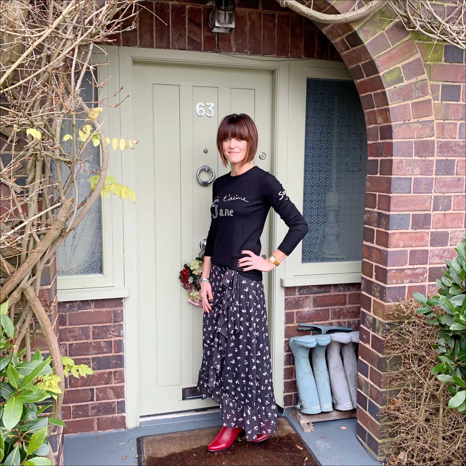 my midlife fashion, bella freud je t'aime jane merino wool sweater, ganni tilden floral print mesh midi wrap skirt, jones the bootmaker harriet leather ankle boot