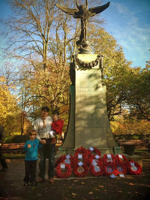 Standing with the poppy wreaths at the cenotaph - remembrance day service