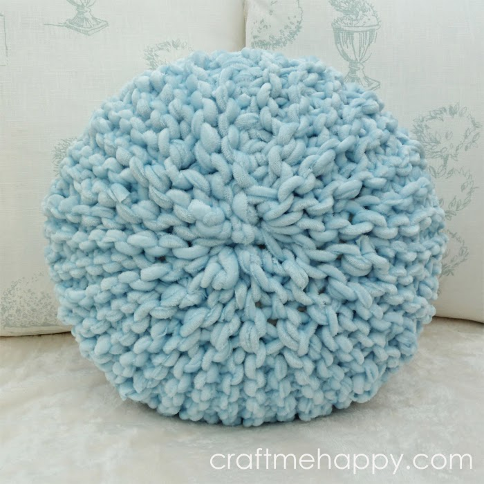Small round knitted pillow.