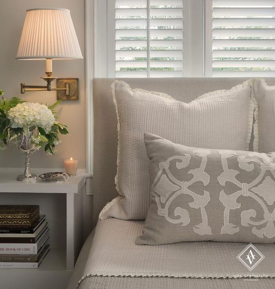 Beautiful bedroom with white plantation shutters