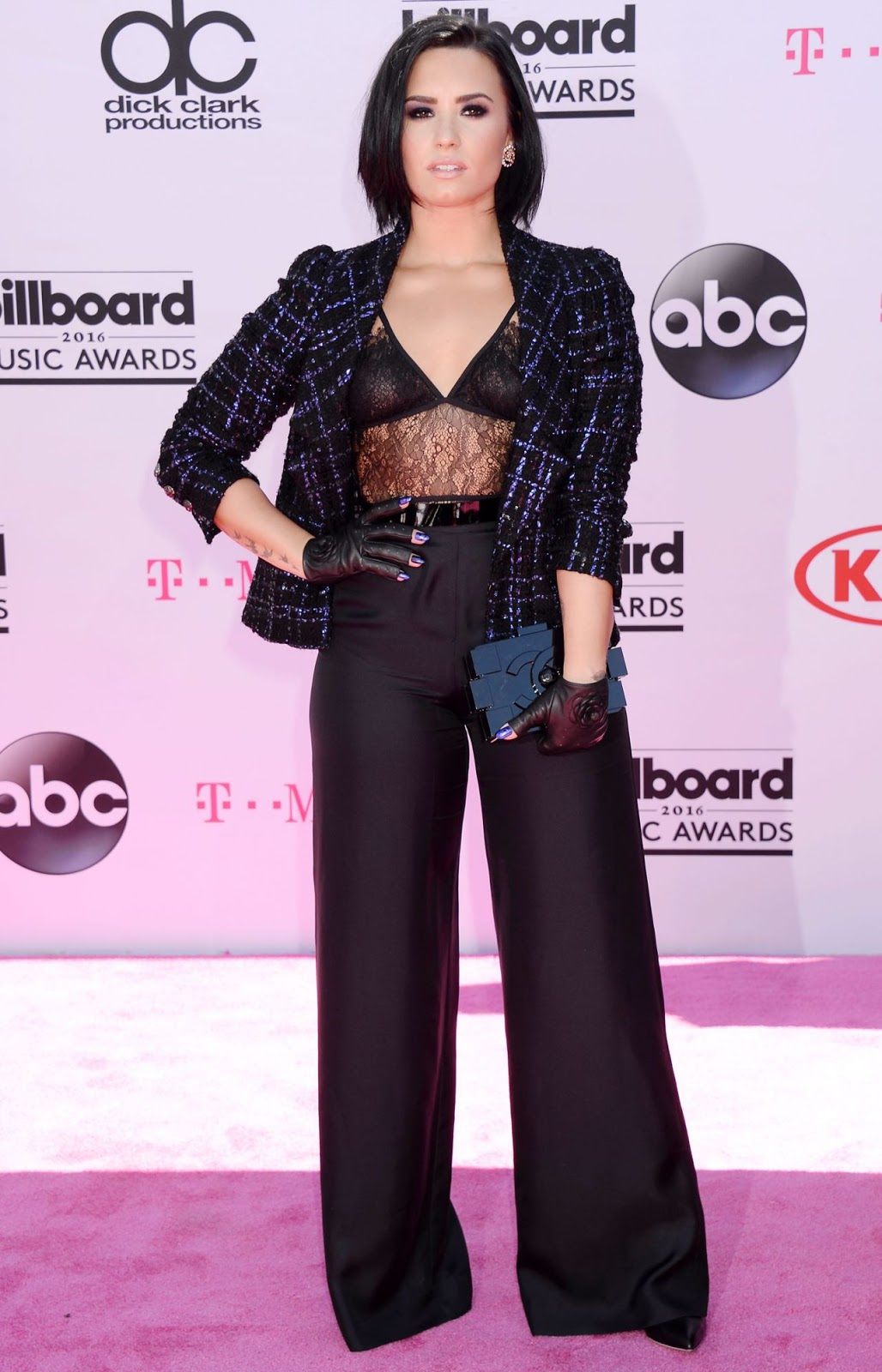 Demi Lovata wears lace bra top to the Billboard Music Awards 2016