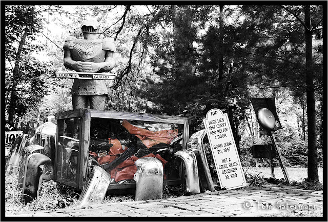 A car tomb guarded by a knight at Pollard's Collection - Salem, IL.