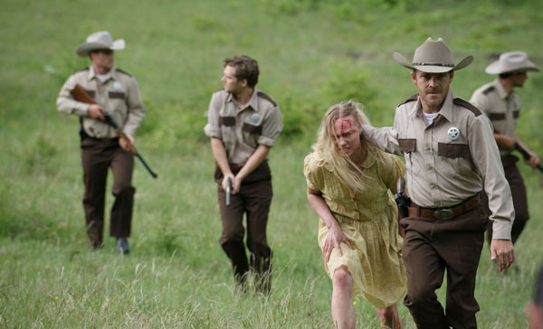 Sheriff Hal Hartman (Stephen Dorff) and his deputies in pursuit for the escaped mental patients in LEATHERFACE (2017)